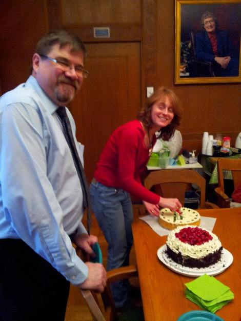 Bob Scheffel and Christine Ridarsky get ready to dig into the cheesecake and the black forest cake that Bob's wife made.